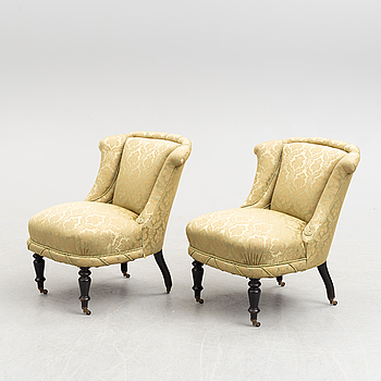A pair of late 19th Century easy chairs.