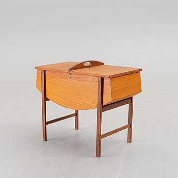 A mid 20th century teak sewing table.