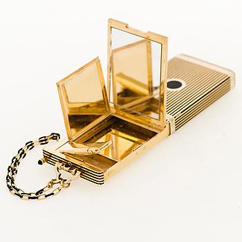 A CARTIER VANITY CASE, 18K gold, enamel, onyx. New York 1940s.