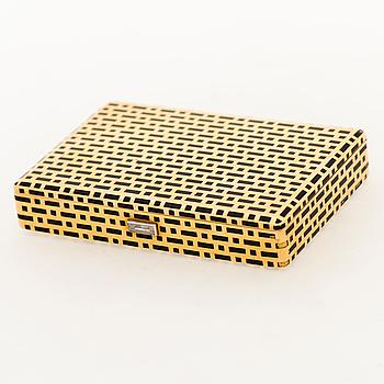 A CARTIER VANITY CASE, 18K gold, enamel, baguette cut diamond. France 1930s.