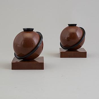 a pair of bakelite 'Saturnus' candle lights.