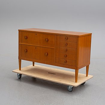 A Swedish Modern walnut veneered chest of drawers, 1940's.