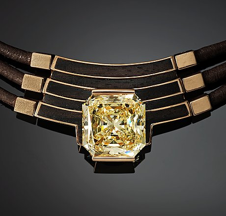 A paul binder necklace with a modified radiant-cut diamond ca 16 cts quality ca fancy light yellow vs/si.