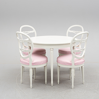 A DINING TABLE AND FOUR CHAIRS, gustavian style, mid 20th century.