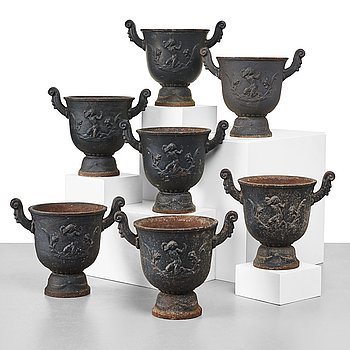 246. Ivar Johnsson, a set of seven Swedish Grace black painted cast iron jardenieres by Näfveqvarns Bruk, Sweden.