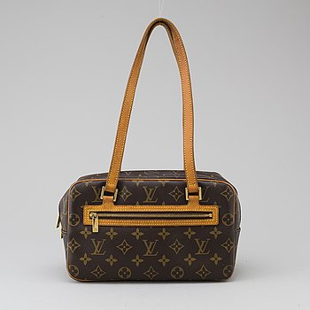 a LOUIS VUITTON ' Cite' bag.