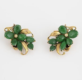 A pair of 14K gold earrings with probably jade.