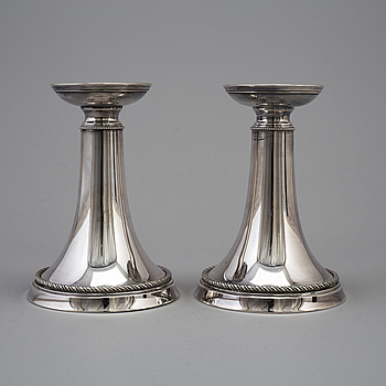 A pair of silver candlesticks by GAB, dated 1953.