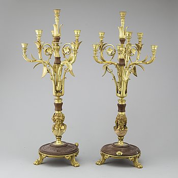 A pair of bronze and wood candelabras, 19th century.