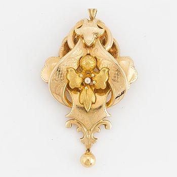 An 18K gold pendant/brooch.