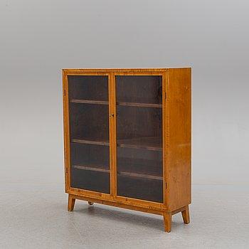 A 1940s birch cabinet.