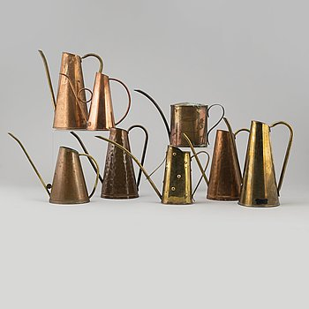Eight 19th and 20th century copper and brass watering cans.