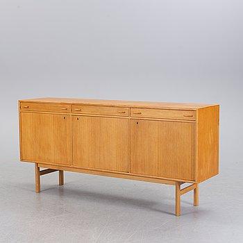 A second half of the 20th century oak veneered sideboard.