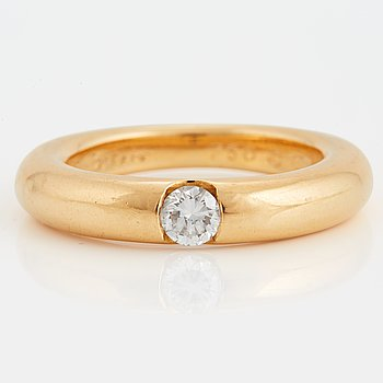 "1016. A Cartier ""Ellipse"" ring set with a round brilliant-cut diamond 0.25 ct according to engraving."
