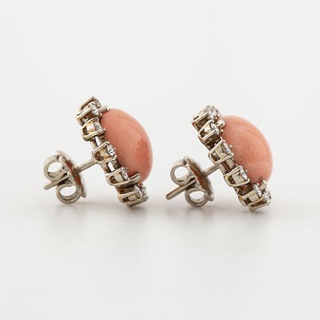 A pair of corall and brilliant cut diamond earrings.