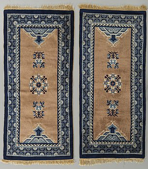 A pair of Chinese old carpets ca 138 x 68 cm.