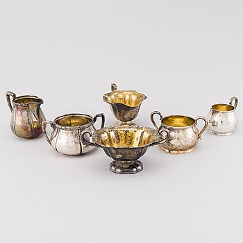 Three pairs of 20th Century silver cream jugs and sugar bowls, Hämeenlinna Finland and one with Finnish import marks.