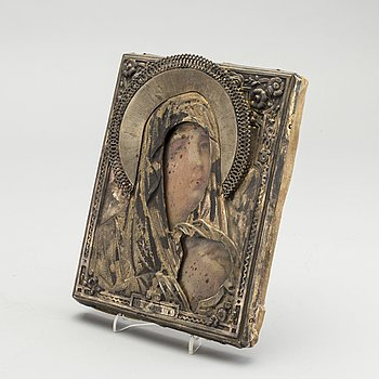 A Russian late 19th century Icon with silver cover.