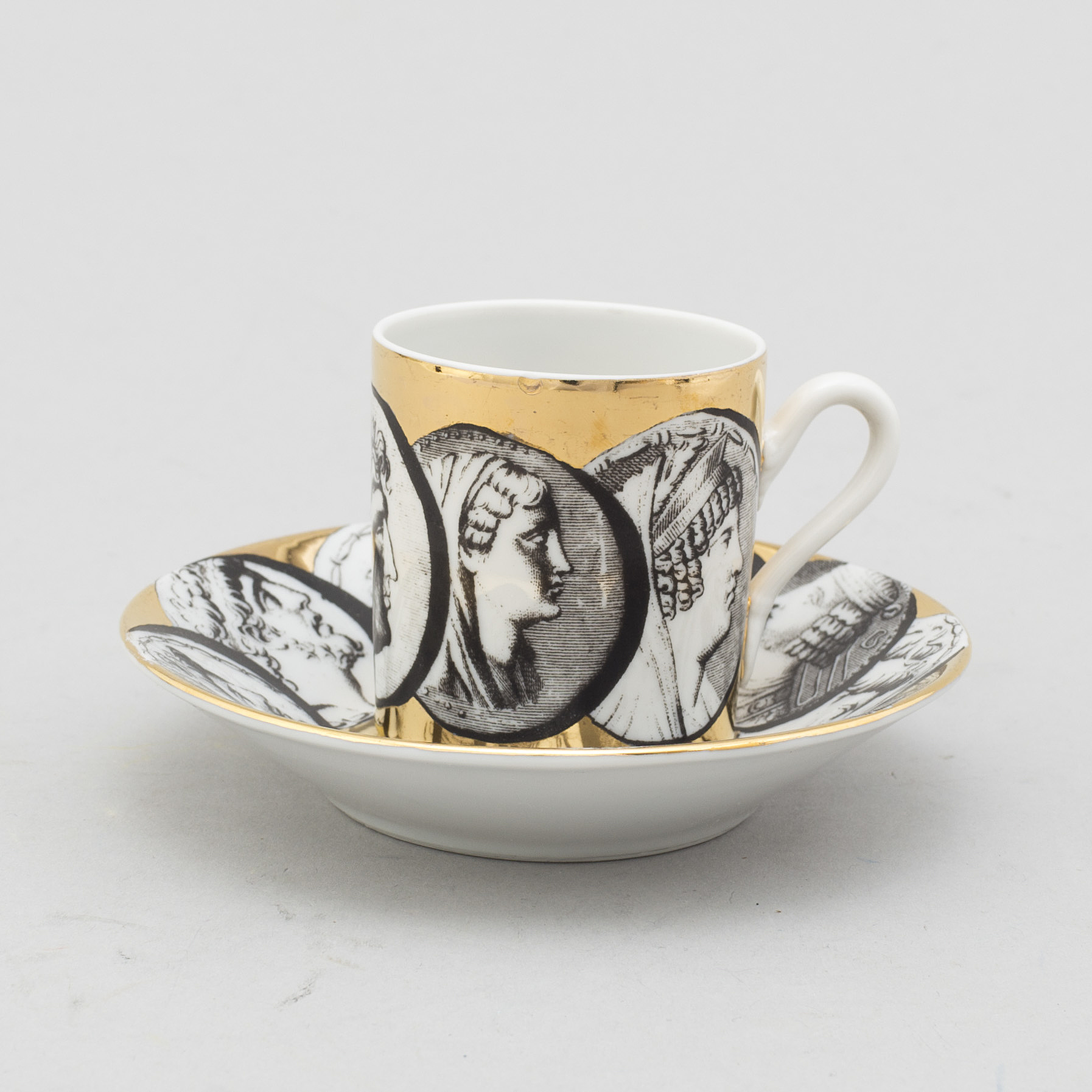 FORNASETTI, eight porcelian espresso cups and saucers from ...