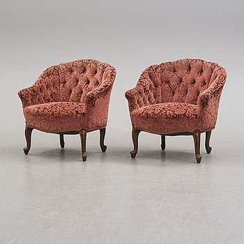 A pair of easy chairs, circa 1900.