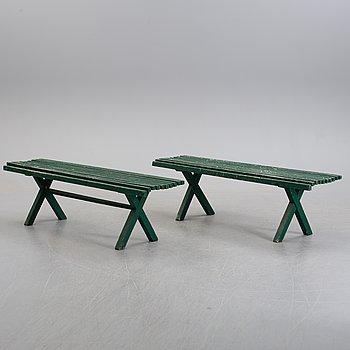 a pair of 20th century garden benches.