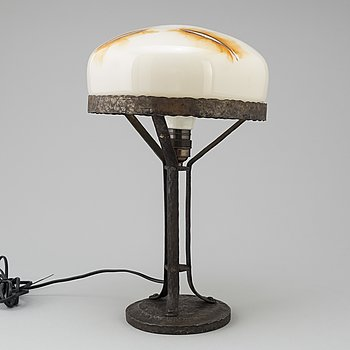 A wrought iron table light, early 20th Century.