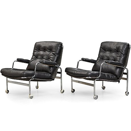 "Bruno mathsson, a pair of ""karin"" easy chairs, dux, sweden, post 1969."