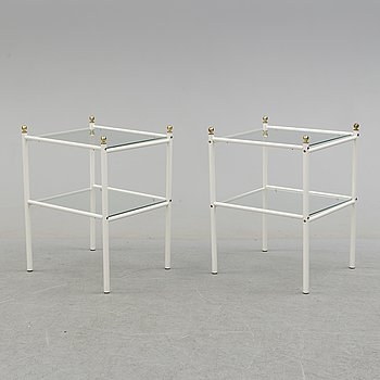 A pair of metal and glass tables, 20th century.