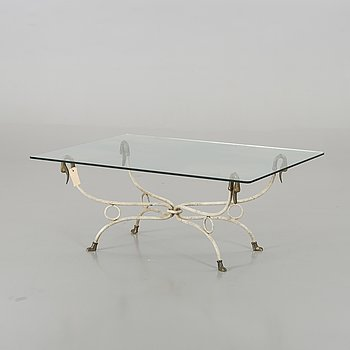 A GLASS TOP COFFEE TABLE SECOND HALF OF 20TH CENTURY.