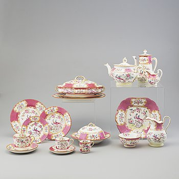 A 47-piece creamware service from Minton, England, early 20th Century.