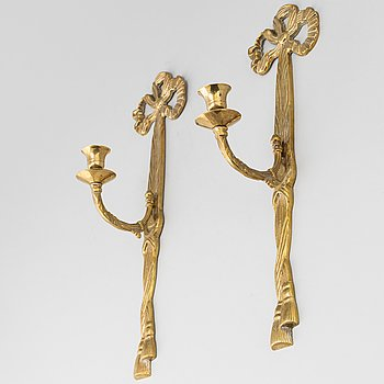 A pair of Louis XVI-style brass wall sconces, mid 20th Century.