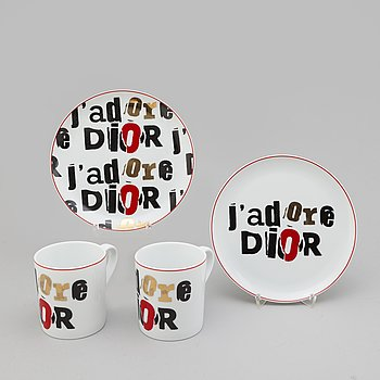 Christian Dior cups with small plates.
