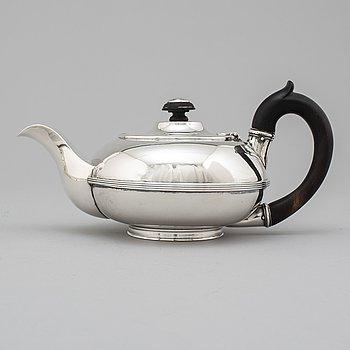 A Russian 19th century parcel-gilt tea-pot, unidentified makers mark, St. Petersburg.