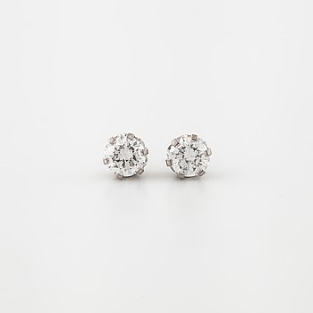 A pair of brilliant cut diamond earrings.