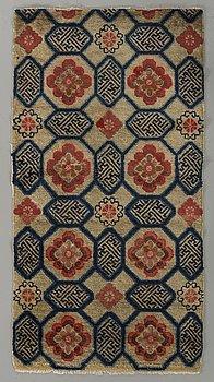A semiantique Tibetan carpet ca 129 x 67 cm.