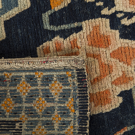 A semaintique chinese carpet ca 73 x 54 cm.