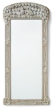 292. Ragnar Östman, attributed to, a sculptured frame Art Nouveau wall mirror, early 20th century.