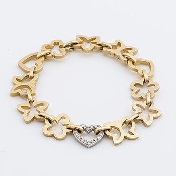 OLE LYNGGAARD ARMBAND 18K guld med briljanthjärta 0,18 ct enligt gravyr.