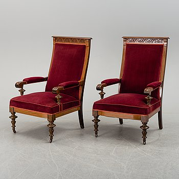 A pair of Late 19th century armchairs.