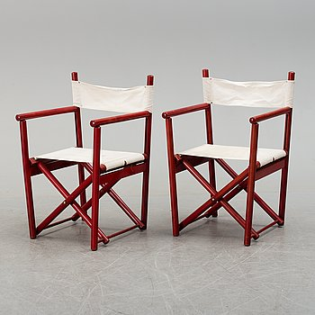a pair of directors chairs from the second half of the 20th century.