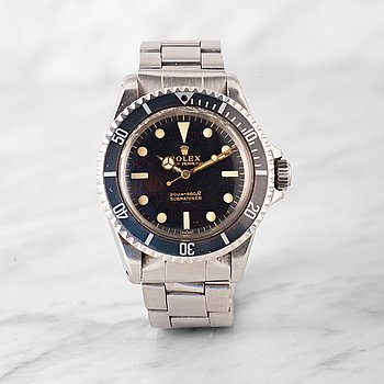 "87. ROLEX, Submariner, ""Underline, Gilt, meters first""."