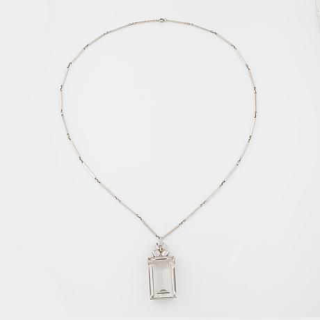 Ateljé stigbert, stockholm, 1945, a faceted rock crystal pendant.