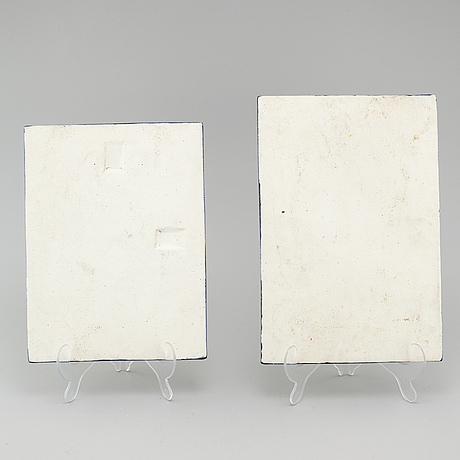 Inger persson, two stoneware wall plaques, not signed