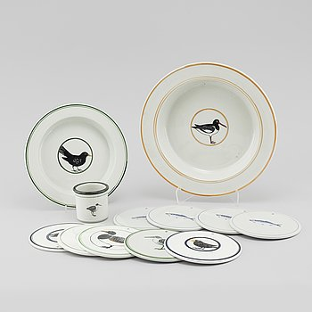 12 pieces of stoneware tableware from Knabstrup in Denmark, decorations by Inger Persson, 1970s/80s.