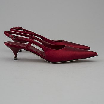 Red silk slingbacks by Sergio Rossi.