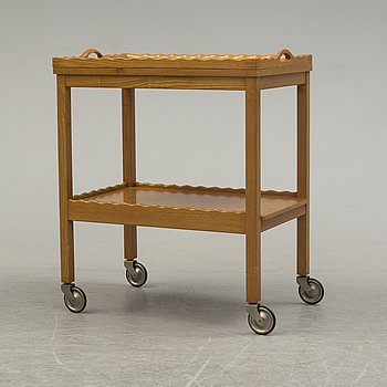 A probably 1940s/1950s elm serving trolley.