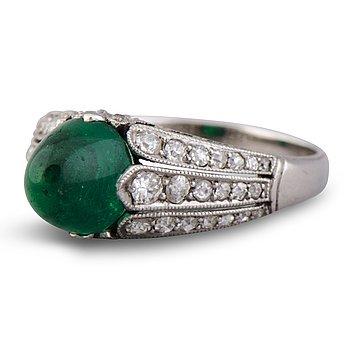 107. A RING, cabochon cut emerald, old cut diamonds. Alexander Tillander, St Petersburg 1855-1918.