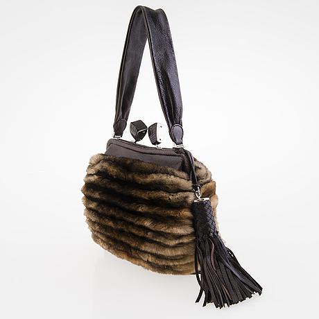 Salvatore Ferragamo Fur Muff Bag. - Bukowskis 6b6e4e3fc5d0f