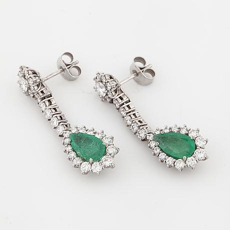 A pair of pear cut emerald and brilliant cut diamond earrings.