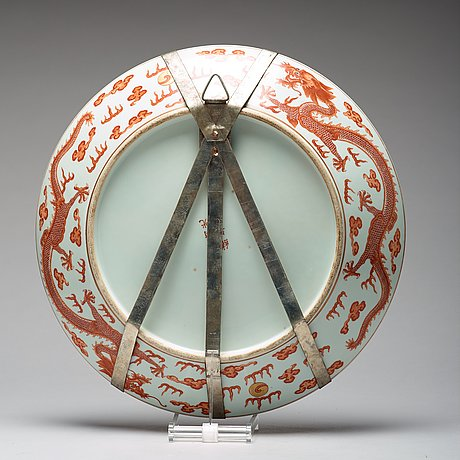 A large iron-red and gilt 'dragon' charger, qing dynasty, with guangxus mark and of the period (1874-1908).